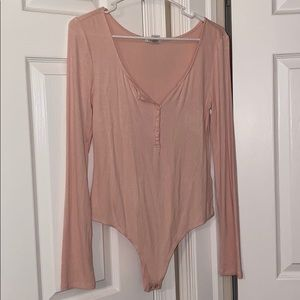 Baby pink button up body suit